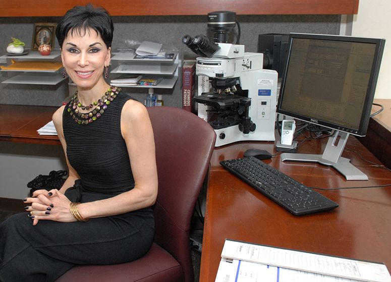 Cynthia M. Magro, MD in her office